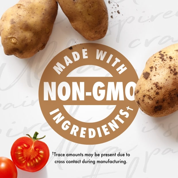 """nutro post that sais """"made with non-gmo ingredients"""" with raw potatoes and cut tomato"""
