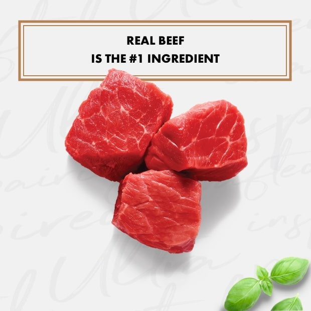 "chunks of raw beef and basil with text that reads ""real beef is the #1 Ingredient"""