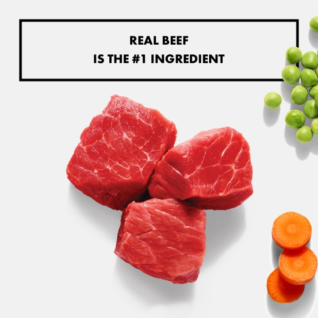 "chunks of raw beef with peas and carrots ""real beef is the #1 ingredient"""