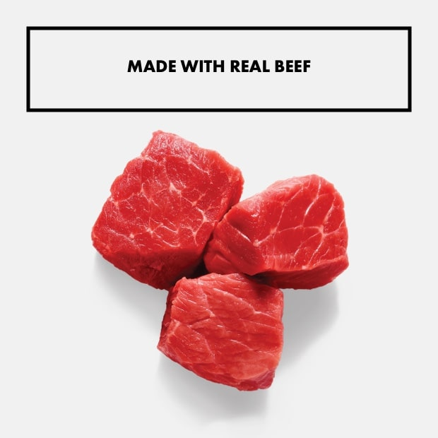 """small chunks of raw beef with text that said """"made with real beef"""""""