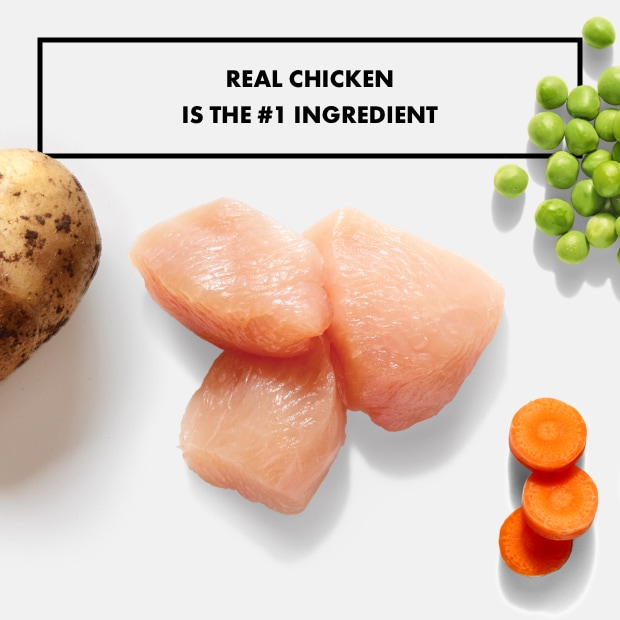 """chunks of raw chicken with basil and potato with text """"real chicken is the #1 ingredient"""""""